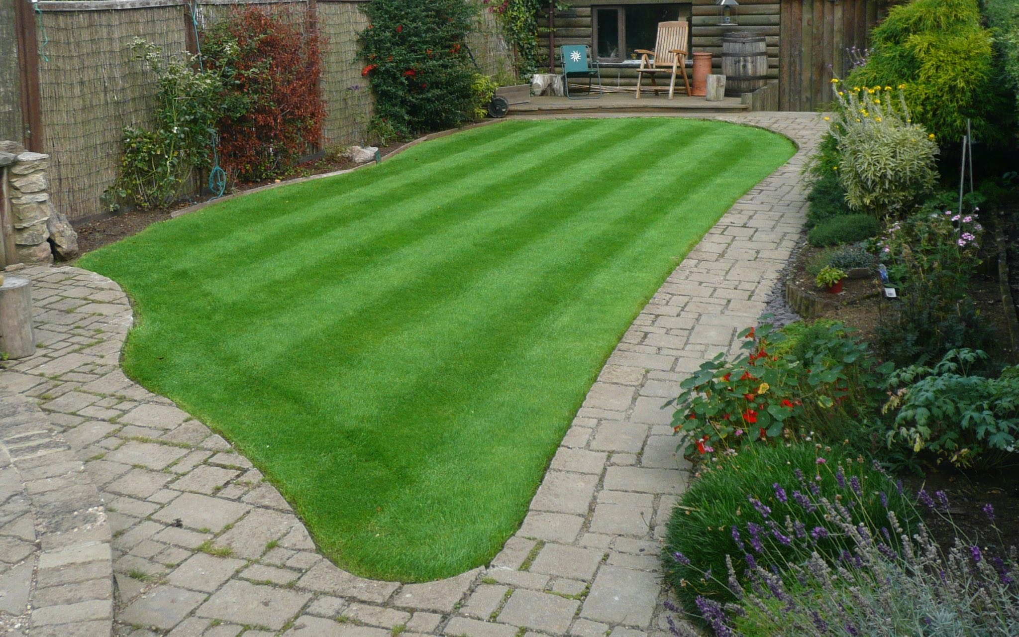 Small bright green lawn with vibrant stripes created using quality organic fertilisers